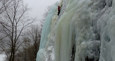 History of Winter (HoW) participants learn to climb on an ice fall near Cascade Lake, Lake Placid, New York, on Feb. 12, 2013.