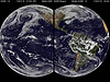 This combination image shows satellite data from NOAA's GOES-13 and GOES-15 depicted as two rounded images of the Earth as if you were simultaneously looking at the Atlantic and Pacific oceans with very wide-set eyes.