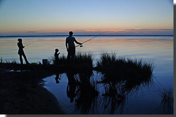 Photo of a family fishing in the Outer Banks taken by Ed Campion.  All rights reserved by Ed Campion.