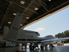 a global hawk drone sits at the entrance to its hangar