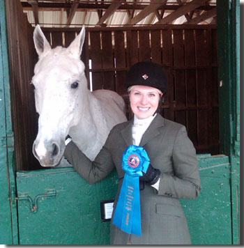 Erin McKinley and her horse, Ghost, win a blue ribbon.