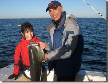 John Hagopian and his son, Matthew, fishing.