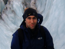 smiling man in a small valley of ice