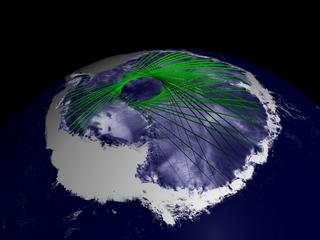 Image shows how ICESat's orbit was designed to maximize coverage over the great polar ice sheets, where ground tracks overlap to create an intricate grid of data points.