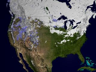 This image displays the snow cover from February 21, 2003 in white. Areas with snow cover on February 21, 2002 but not on February 21, 2003 are shown in blue.