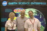 Charlotte Griner, Fritz Hasler and Steve Graham of NASA's Goddard Space Flight Center man NASA's booth at Odyssey.