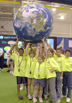 Students at Odyssey's 2003 Finals hold NASA's satellite image recreation of the world.