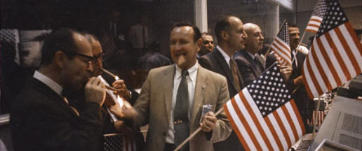 NASA officials and flight controllers celebrate the successful conclusion of Apollo 11