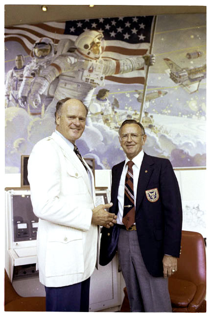 Artist Robert McCall (left) and JSC Director Christopher Kraft