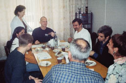 Astronaut Clayton Anderson shares a meal with Russian colleagues