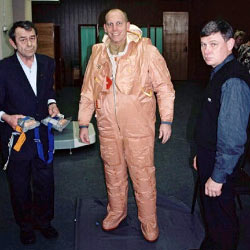 Clayton Anderson tries on a Russian Forel suit