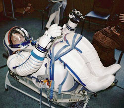Clayton Anderson tries on a Russian Sokol suit