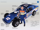 A pop-up structure with color photographs and text illustrating auto racing products which have emerged from space technology.