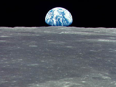 AS11-44-6549 -- Earth rising above the moon's horizon