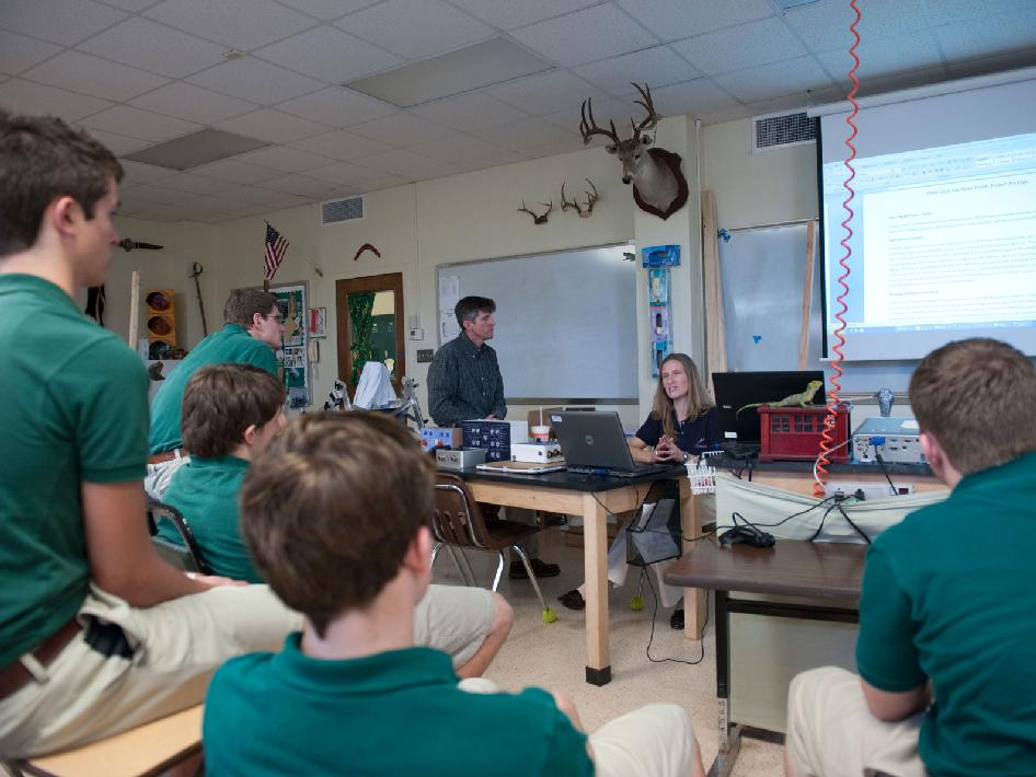 Christie Sauers and Jeff Fox present project details to students