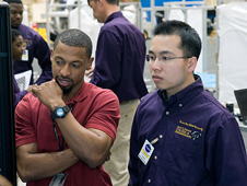 JSC2012-E-032510 -- NASA engineer Cecil Shy and Prairie View senior Toan Nguyen
