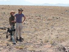 jsc2011e119255 -- Heather Paul (left) stands with Bill Stafford (right) in Black Point Lava Flow in Arizona while shooting footage for the Desert RATS education and public outreach videos.