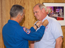 wstf0807e05750 -- NASA Astronaut Danny Olivas pins the Silver Snoopy on Robert Mitchell