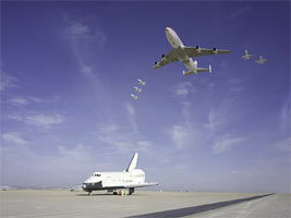 The NASA 747 carrier aircraft and five T-38 aircraft flew over Space Shuttle Enterprise