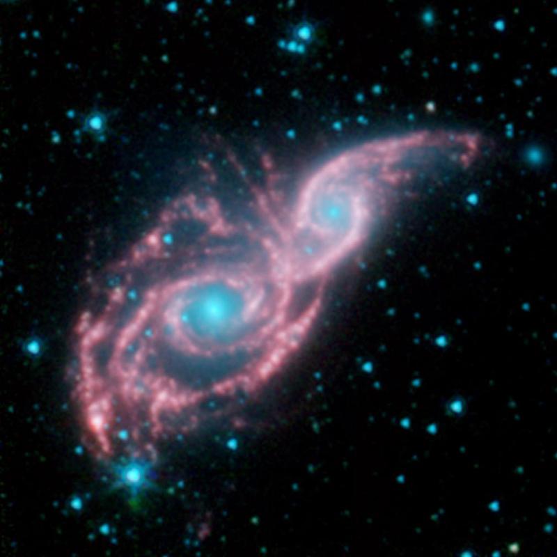 Nasa Galaxies Don Mask Of Stars In New Spitzer Image
