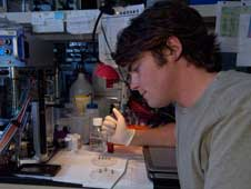 intern Dennis Murray adds material to lab on a chip