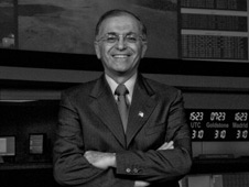 Dr. Charles Elachi stands in Mission Control at NASA's Jet Propulsion Laboratory in Pasadena, Calif.,