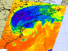 The storm's coldest cloud top temperatures and intense rains are shown in purples and blues.