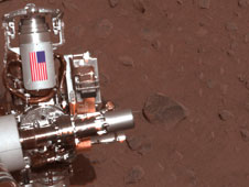 The piece of metal with the American flag on it in this image of a NASA rover on Mars.