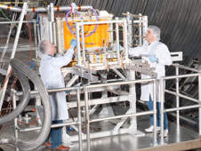 NASA Engineers and Technicians transporting the SCAN Testbed