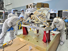The MIRI Cleanroom Huddle: Although it appears that these six contamination control engineers are in a huddle around the James Webb Space Telescope's Mid-Infrared Instrument (or MIRI)
