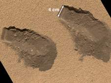 This is a view of the third (left) and fourth (right) trenches made by the 1.6-inch-wide (4-centimeter-wide) scoop on NASA's Mars rover Curiosity in October 2012.