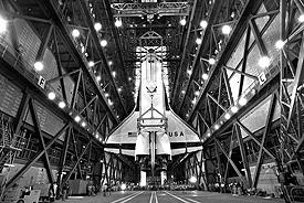 Columbia is hoisted off the ground inside of NASA's Vehicle Assembly Building.
