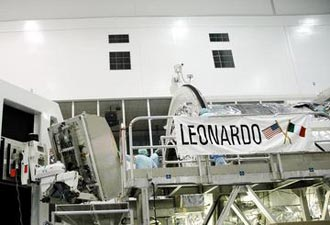 The Multi-Purpose Logistics Module Leonardo is loaded with a payload at the Space Station Processing Facility.