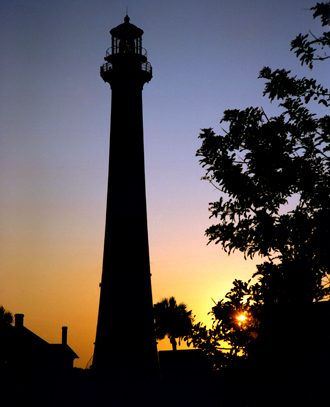 The sun rises behind the Cape Canaveral Lighthouse.