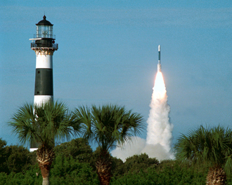 A rocket lifts off near the lighthouse on Cape Canaveral.
