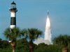 A rocket lifts off near the Cape Canaveral Lighthouse.