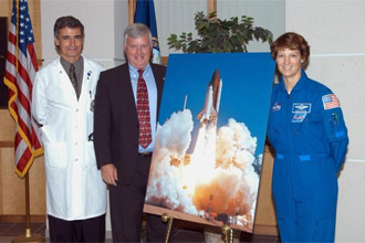 Dr. Thomas Howard, Kennedy Space Center Director Jim Kennedy and STS-114 Commander Eileen Collins