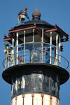 Workers atop the Cape Canaveral Lighthouse lamp room.