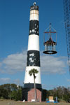 Workers at the Cape Canaveral Lighthouse remove the lamp room.