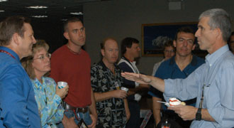 NASA engineer Bill McQuade talkes to fellow workers at Kennedy Space Center.