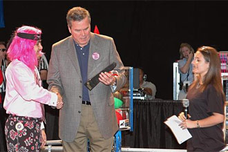 Florida Governor Jeb Bush receives a trophy from students Sam Mallikarjunan and Stephanie Alphonso