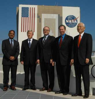 Heads from the space agency partners meet at Kennedy Space Center.
