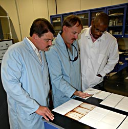 Engineers Jeff Herrington, Jerry Curran and Kevin Andrews compare test panels.