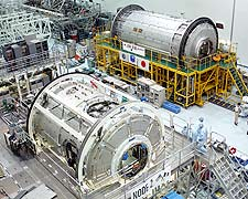 U.S. Node 2 and Japanese Experiment Module elements in Kennedy's space station processing facility.