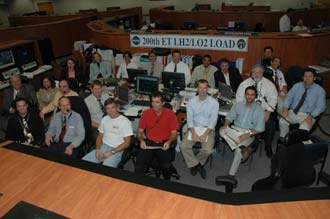 External Tank 200th tanking group gathered in Firing Room 4.