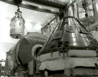 The Apollo 11 and Apollo 12 command and service modules are shown inside the high bay.