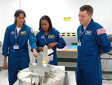 STS-116 Mission Specialists Sunita Williams, Joan Higginbotham and Nicholas Patrick look over flight hardware.