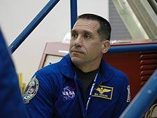Mission STS-116 Pilot William Oefelein at the SPACEHAB Payload Processing Facility.