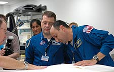 STS-116 Commander Mark Polansky and Mission Specialists Sunita Williams and Nicholas Patrick inspect fight hardware.