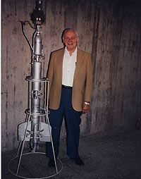 Konrad Dannenberg standing next to the R-7 rocket